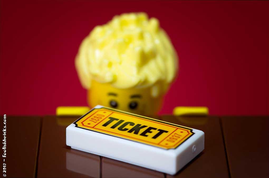 lego boy staring at ticket