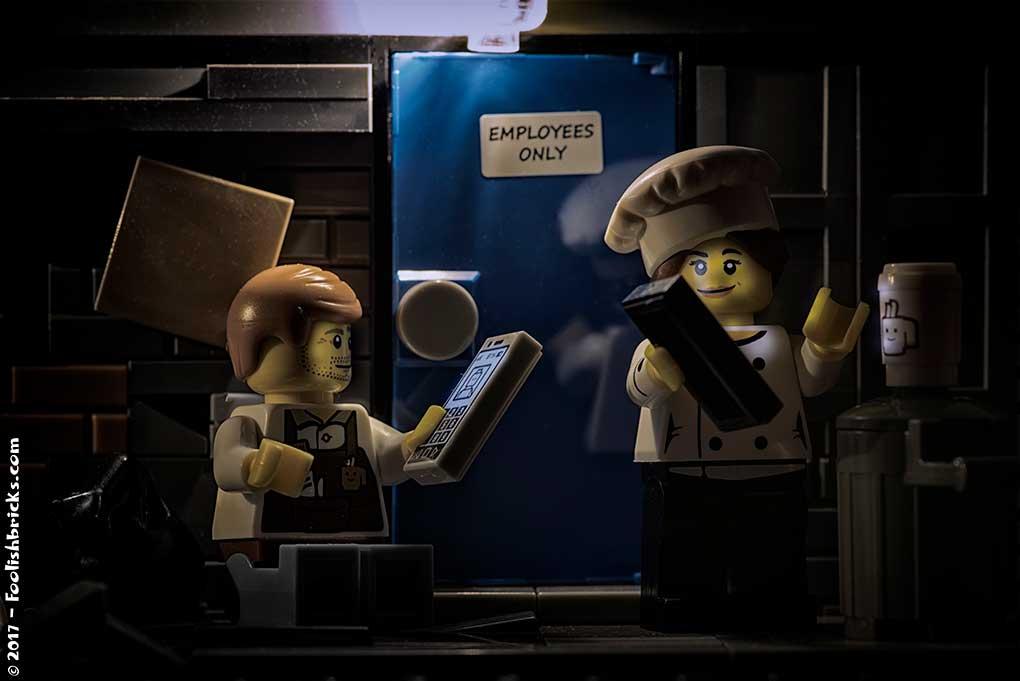 lego employees enjoying coffee break with smartphone