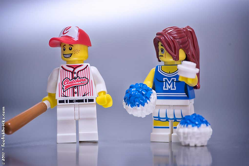 A lego baseball player accidentally gave a cheer leader a black eye with the ball