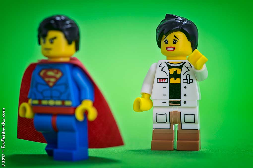 lego superman is annoyed by woman with batman t-shirt