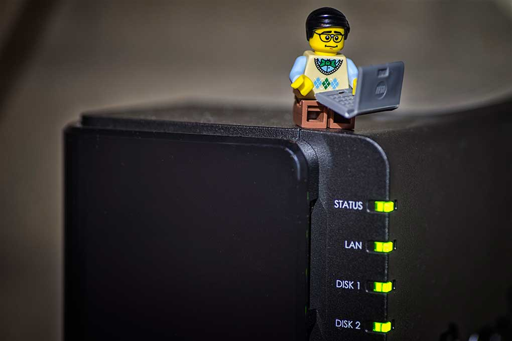 lego programmer with laptop on top of a server