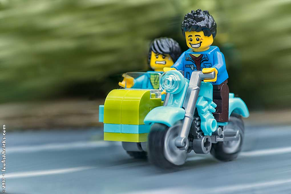 Two lego guys cruising in motorcycle with sidepod