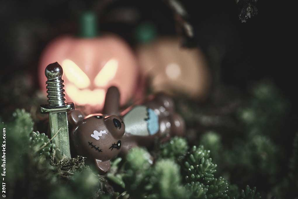 halloween teddybear in the woods with knife