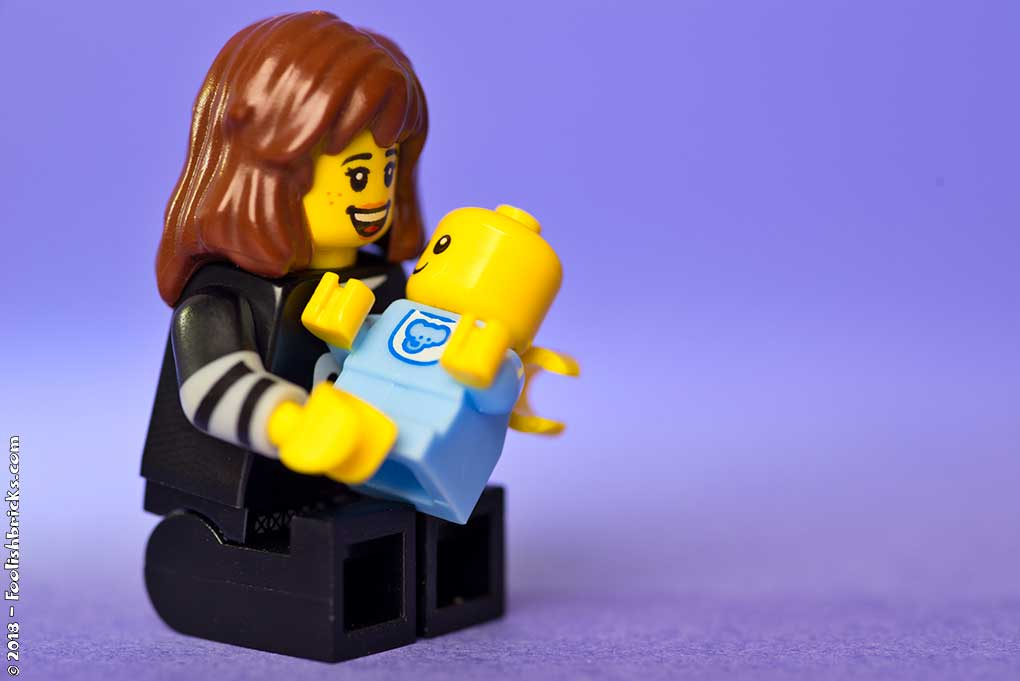 lego woman with a baby in her arms