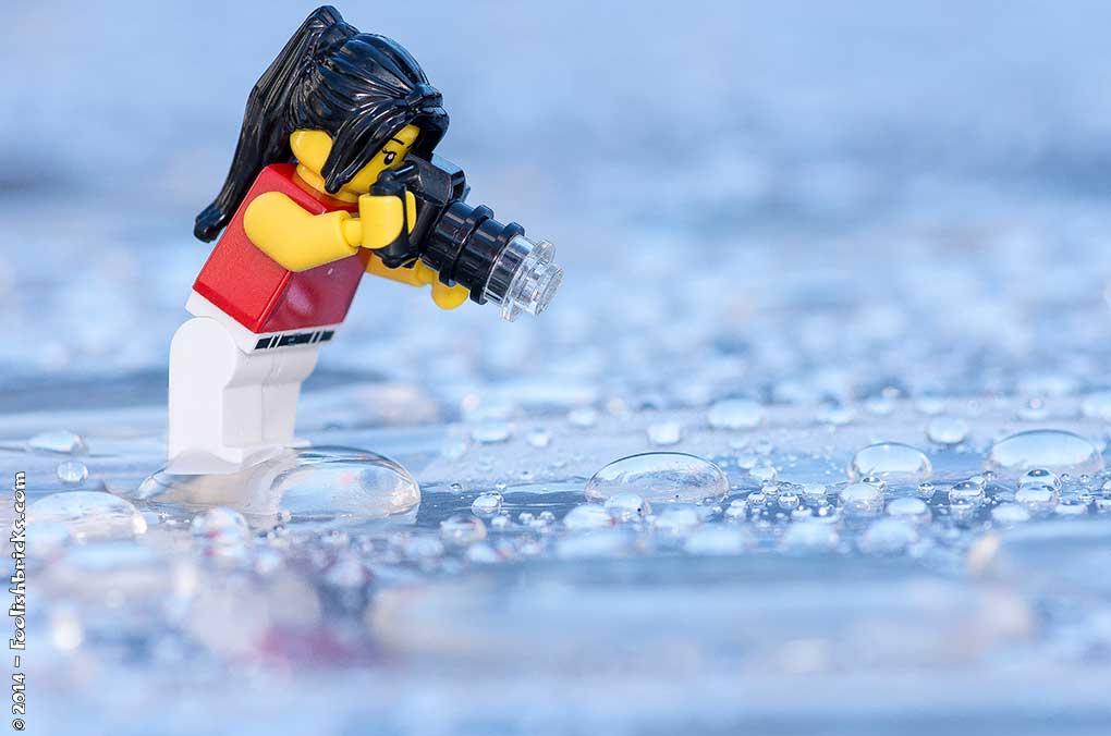 Lego photography - toy photographer rain drops