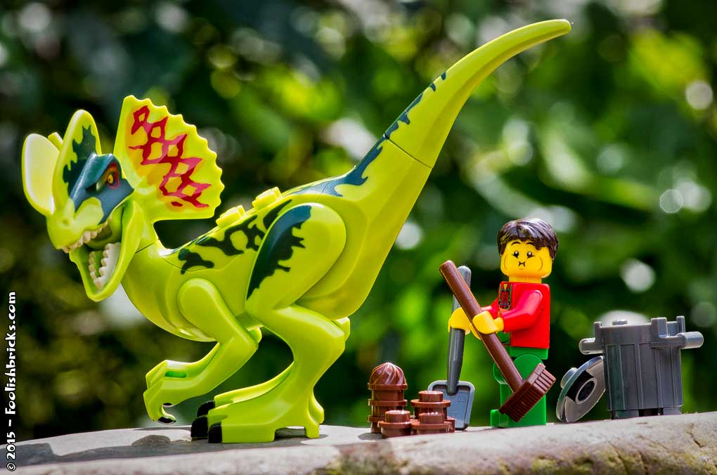 a Lego 'spectacular job at Jurassic Park, cleaning up after the dinosaurs