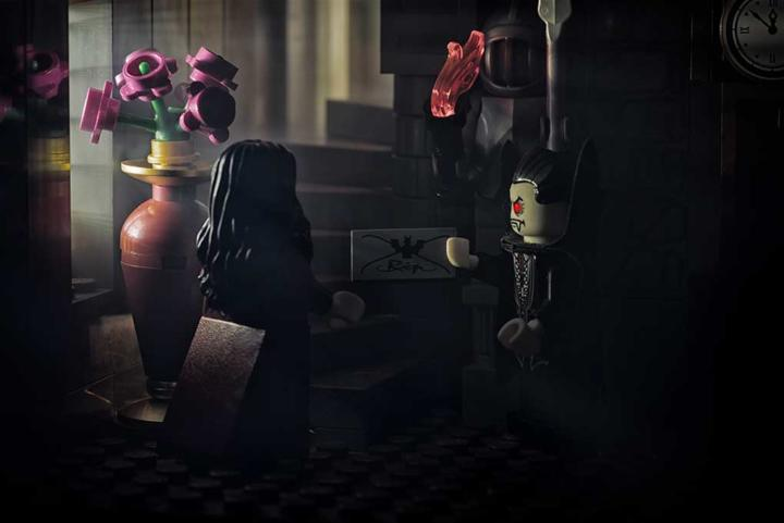 lego vampire presents his wife with a letter in a dark castle